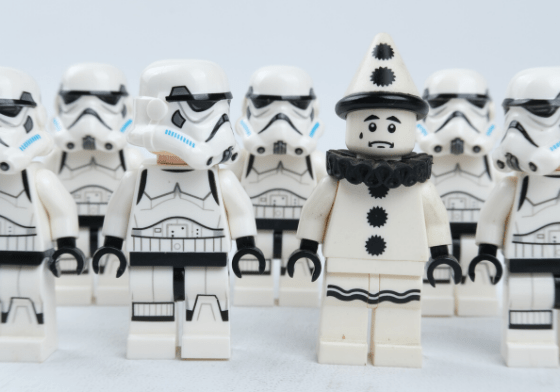 A group of lego storm troopers and one worried looking lego clown